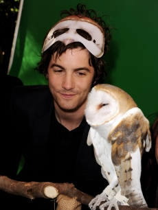 "Jim Sturgess poses with an owl at the pre-party for the premiere of ""Legend of The Guardians: The Owls of Ga'Hoole"" at the Chinese Theater in Los Angeles on September 19, 2010"