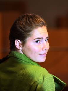 Defendant Amanda Knox takes a seat next to her lawyers on the final day of the Meredith Kercher murder trial in Perugia, Italy, December 4, 2009