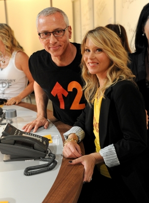 Dr. Drew Pinsky and breast cancer survivor Christina Applegate answer phones at the Stand Up To Cancer event at Sony Pictures Studios, Culver City, on September 10, 2010