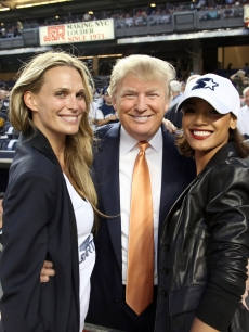Molly Sims, Donald Trump and Selita Ebanks pose together at Starter Day at Yankee Stadium, NYC, September 23, 2010
