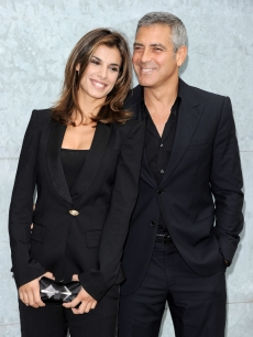 Elisabetta Canalis and George Clooney attend the Giorgio Armani Spring/Summer 2011 fashion show during Milan Fashion Week Womenswear in Milan, Italy on September 27, 2010