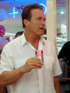 "Arnold Schwarzenegger sips on O.N.E. Coconut Water at an event celebrating daughter Katherine's book, ""Rock What You've Got,"" Santa Monica, Sept. 25, 2010"