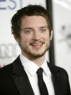 Elijah Wood poses for the LA press
