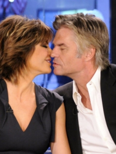 "Lisa Rinna and Harry Hamlin share a kiss during a visit to ""Today,"" NYC, Oct. 5, 2010"
