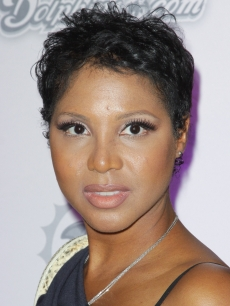 Toni Braxton arrives at the Miami Dolphins versus the New England Patriots game at Sun Life Stadium in Miami, Florida on October 4, 2010