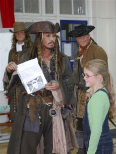 Johnny Depp holds a letter from 5-year-old Bea Delap inviting him to attend her school assembly in London on October 7, 2010