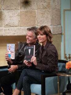 Lisa Rinna and Harry Hamlin bring their books by the Access Hollywood Live set on October 13, 2010