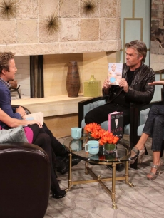 Lisa Rinna and Harry Hamlin pay Billy Bush and Kit Hoover a visit on Access Hollywood Live on October 13, 2010