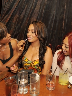 Kelly Rowland applies lipgloss to LaLa Vazquez while Trina looks on At TAO in Las Vegas on October 15, 2010Kelly Rowland applies lipgloss to LaLa Vazquez while Trina looks on At TAO in Las Vegas on October 15, 2010
