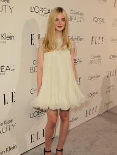 The adorable Elle Fanning poses on the red carpet of ELLE's 17th Annual Women in Hollywood Tribute at The Four Seasons Hotel on October 18, 2010 in Beverly Hills