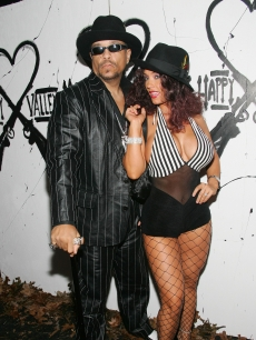 Ice-T and his wife Coco attend Heidi Klum's 6th annual Halloween party at Happy Valley in New York City on October 31, 2005