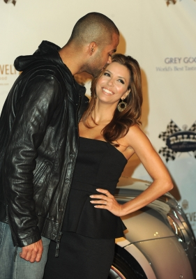 "Tony Parker gives Eva Longoria Parker a kiss as the couple arrives to the 2nd Annual Rally for Kids With Cancer ""The Qualifiers"" Celebrity Draft Party in Hollywood on October 22, 2010"
