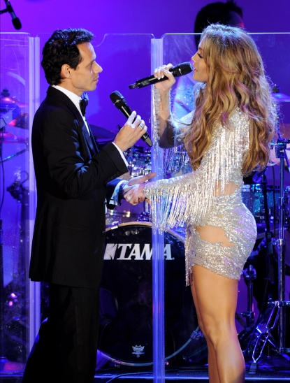 Marc Anthony and Jennifer Lopez share a sweet moment while performing together at The 32nd Annual Carousel Of Hope Ball at The Beverly Hilton hotel in Beverly Hills on October 23, 2010 