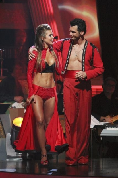 "Audrina Patridge and Tony Dovolani exchange a knowing glance as they prepare to learn their fate on ""Dancing with the Stars,"" Oct. 26, 2010"