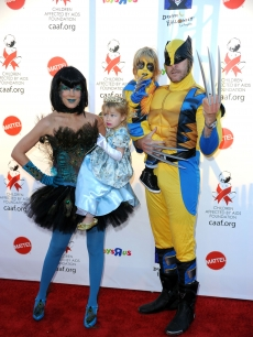 Tori Spelling (as a peacock), daughter Stella, son Liam, and Dean McDermott (as Wolverine) arrive at the Children Affected By AIDS Foundation's 17th Annual Dream Halloween event at Barker Hanger in Santa Monica on October 30, 2010