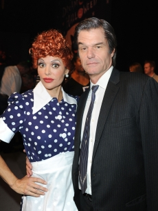 Lisa Rinna (as Lucille Ball) and Harry Hamlin (as Desi Arnaz) arrive at the Children Affected By AIDS Foundation's 17th Annual Dream Halloween event at Barker Hanger in Santa Monica on October 30, 2010