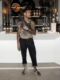 "Maroon 5 frontman Adam Levine dresses up as Bruce Willis' ""Die Hard"" character John McClane at Bacardi's Halloween bast at the Hollywood Forever Cemetery in LA on October 31, 2010"