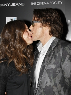 "Susan Downey and Robert Downey Jr. share a moment at the Cinema Society & DKNY Jeans screening of ""Due Date"" at AMC Loews Lincoln Square 13 theater in New York City on November 1, 2010"