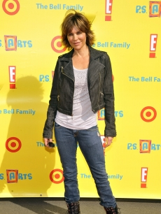 "Lisa Rinna poses for a picture at the PS Arts 'Express Yourself 2010"" charity event held at the Barker Hanger in Santa Monica, Calif. on November 7, 2010"