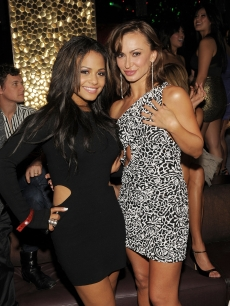 Christina Milian and Karina Smirnoff smile as they attend TAO's 5th Anniversary, Las Vegas, Nov. 6, 2010