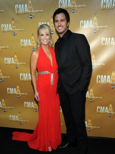 Luke Bryan and his wife attend the 44th Annual CMA Awards at the Bridgestone Arena in Nashville, Tennessee, on November 10, 2010