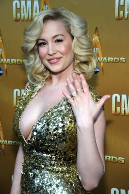 Kellie Pickler flashes her engagement ring at the 44th Annual CMA Awards at the Bridgestone Arena in Nashville, Tennessee, on November 10, 2010 