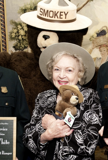 Betty White poses for photographers after she named a honorary Forest Ranger outside of the John F. Kennedy Center for the Performing Arts in Washington, DC. on November 9, 2010