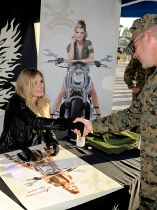 Supermodel Marisa Miller signs autographs for Marines during a Harley-Davidson event at Camp Pendleton on November 9, 2010 in Oceanside, Calif.