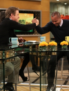 """Skyline's"" Donald Faison shows Billy Bush some love on Access Hollywood Live on November 12, 2010"