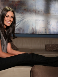"""The Event"" star Taylor Cole kicks her feet up backstage on Access Hollywood Live on November 15, 2010"