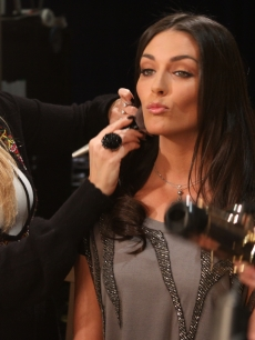"""The Event"" beauty Taylor Cole gets a quick touch up before her interview on Access Hollywood Live on November 15, 2010"