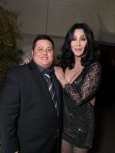 "Chaz Bono and Cher pose together at the ""Burlesque"" premiere at Grauman's Chinese Theatre on November 15, 2010 in Hollywood"