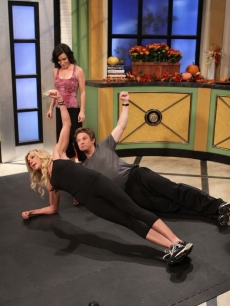 Jackie Warner teaches Billy Bush and Kit Hoover some fun workout moves on Access Hollywood Live on November 17, 2010