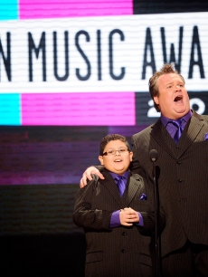 """Modern Family's"" Rico Rodriguez and Eric Stonestreet present an award at the 2010 American Music Awards held at Nokia Theatre L.A. Live in Los Angeles on November 21, 2010"