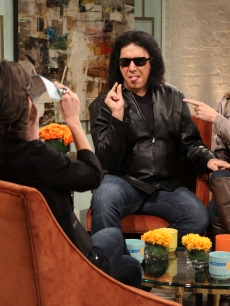 Gene Simmons and Shannon Tweed chat with Billy Bush and Kit Hoover on Access Hollywood Live on November 29, 2010, as Gene shows off his famous asset