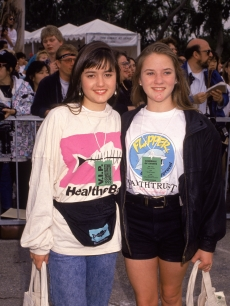 Danica McKellar and Crystal McKellar stand with their arms around each other at Earth Walk, 1992