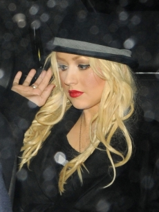 Christina Aguilera is spotted leaving her hotel in London on December 12, 2010 