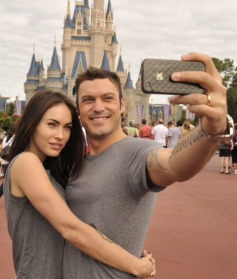 Brian Austin Green and Megan Fox take a souvenir photo Disney World in Lake Buena Vista, Florida on November 26, 2010 