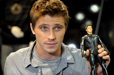 "Garrett Hedlund gives a smile at Disney's ""Tron: Legacy"" booth during Comic-Con 2010 at San Diego Convention Center on July 23, 2010"