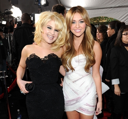Kelly Osbourne and singer Miley Cyrus arrive at the 2010 American Music Awards held at Nokia Theatre L.A. Live in Los Angeles on November 21, 2010