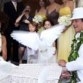 Carlos Santana and Cindy Blackman release doves during their wedding ceremony on December 19, 2010 in Maui