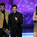 Robert Pattinson, Taylor Lautner, and Kristen Stewart accept the Favorite Movie award onstage during the 2011 People&#8217;s Choice Awards at Nokia Theatre L.A. Live in Los Angeles on January 5, 2011