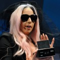 Lady Gaga displays the GL30 Instant Digital Camera as she unveils the Polaroid Grey Label of products she co-designed at the 2011 International Consumer Electronics Show at the Las Vegas Convention Center January 6, 2011.