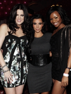 Kim Kardashian, Khloe Kardashian and TV/radio personality and local ambassador Bonang Mathebe step out at the Rand Club in Johannesburg, South Africa on December 16, 2010