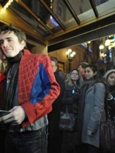 "Reeve Carney of ""Spider-Man: Turn Off The Dark"" poses for photos with fans outside of the Foxwoods Theater in NYC"