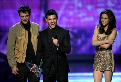 Robert Pattinson, Taylor Lautner, and Kristen Stewart accept the Favorite Movie award onstage during the 2011 People's Choice Awards at Nokia Theatre L.A. Live in Los Angeles on January 5, 2011