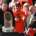 San Francisco Giants manager Bruce Bochy carries the World Series trophy at the conclusion of the Giants&#8217; victory parade, San Francisco, November 3, 2010