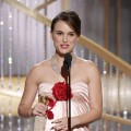 Natalie Portman accepts the award for Best Actress in a Motion Picture Drama for &#8216;Black Swan&#8217; onstage during the Golden Globes at the Beverly Hilton International Ballroom in Beverly Hills on January 16, 2011