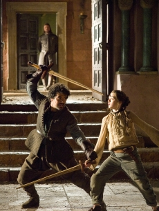 "Sean Bean as Ned Stark, Miltos Yeromelou as Syrio Forel and Maisie Williams as Arya Stark in ""Game of Thrones,"" 2011"