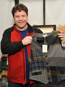 Sean Astin checks out his new vest by What Goes Around Comes Around Vintage-inspired Apparel